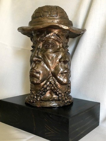 Four Faces Under a Hat